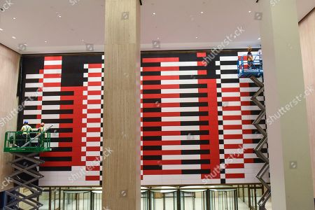 """IMAGE DISTRIBUTED FOR TISHMAN SPEYER- Workers unveil a reproduction of Josef Albers' """"Manhattan"""" mural at 200 Park Avenue (MetLife Building) on in New York. Nearly 20 years since the original mural's removal, real estate companies Tishman Speyer and Irvine Company brought back the iconic mid-century mural to the building with help from the Josef and Anni Albers Foundation and the artist's original plans"""