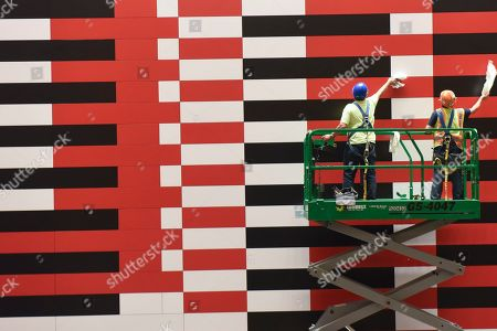 """IMAGE DISTRIBUTED FOR TISHMAN SPEYER- Workers clean a reproduction of Josef Albers' """"Manhattan"""" mural at 200 Park Avenue (MetLife Building) on . Nearly 20 years since the original mural's removal, real estate companies Tishman Speyer and Irvine Company brought back the iconic mid-century mural to the building with help from the Josef and Anni Albers Foundation and the artist's original plans"""