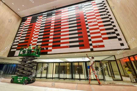 """IMAGE DISTRIBUTED FOR TISHMAN SPEYER- Workers clean a reproduction of Josef Albers' """"Manhattan"""" mural at 200 Park Avenue"""
