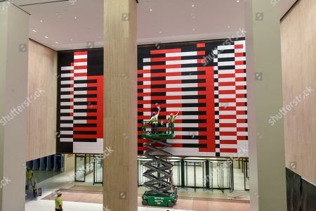 """IMAGE DISTRIBUTED FOR TISHMAN SPEYER- Workers clean reproduction of Josef Albers' """"Manhattan"""" mural at 200 Park Avenue (MetLife Building) . Nearly 20 years since the original mural's removal, real estate companies Tishman Speyer and Irvine Company brought back the iconic mid-century mural to the building with help from the Josef and Anni Albers Foundation and the artist's original plans"""