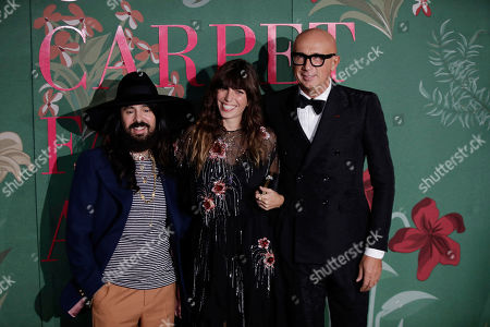 From left, Alessandro Michele, Lou Doillon, Marco Bizzarri upon their arrival at the Green Carpet Fashion Awards in Milan, Italy