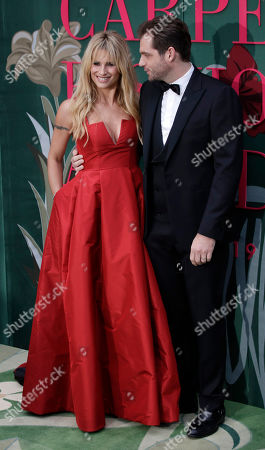 Stock Image of Michelle Hunziker and Tomaso Trussardi pose upon their arrival at the Green Carpet Fashion Awards in Milan, Italy