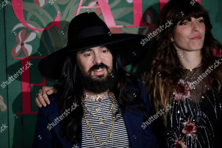 Alessandro Michele is flanked by Lou Doillon upon their arrival at the Green Carpet Fashion Awards in Milan, Italy