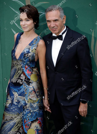 Carlo Capasa and Stefania Rocca pose upon arrival at the Green Carpet Fashion Awards in Milan, Italy