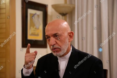 Former President Hamid Karzai speaks during an interview in Kabul, Afghanistan