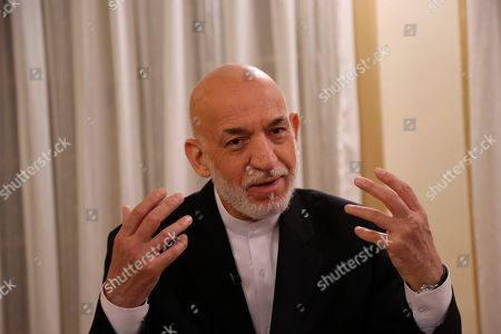 Former Afghan President Hamid Karzai speaks during an interview in Kabul, Afghanistan