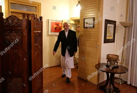 Former Afghan President Hamid Karzai arrives for an interview in Kabul, Afghanistan
