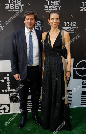 Demetrio Albertini and his wife Uriana Capone arrive to attend the Best FIFA soccer awards, in Milan's La Scala theater, northern Italy, . Netherlands defender Virgil van Dijk is up against five-time winners Cristiano Ronaldo and Lionel Messi for the FIFA best player award and United States forward Megan Rapinoe is the favorite for the women's award