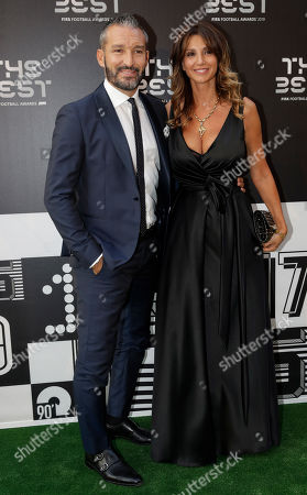 Gianluca Zambrotta and his wife Valentina arrive to attend the Best FIFA soccer awards, in Milan's La Scala theater, northern Italy, . Netherlands defender Virgil van Dijk is up against five-time winners Cristiano Ronaldo and Lionel Messi for the FIFA best player award and United States forward Megan Rapinoe is the favorite for the women's award