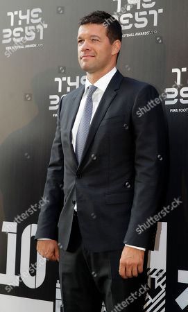 Michael Ballack arrives to attend the Best FIFA soccer awards, in Milan's La Scala theater, northern Italy, . Netherlands defender Virgil van Dijk is up against five-time winners Cristiano Ronaldo and Lionel Messi for the FIFA best player award and United States forward Megan Rapinoe is the favorite for the women's award