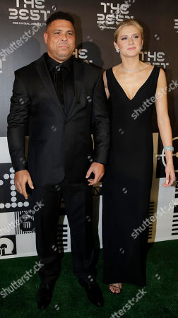 Ronaldo Luis Nazario da Lima is flanked by Celina Locks upon they arrive to attend the Best FIFA soccer awards, in Milan's La Scala theater, northern Italy, . Netherlands defender Virgil van Dijk is up against five-time winners Cristiano Ronaldo and Lionel Messi for the FIFA best player award and United States forward Megan Rapinoe is the favorite for the women's award