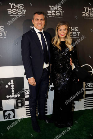 Christian Vieri and Costanza Caracciolo arrive to attend the Best FIFA soccer awards, in Milan's La Scala theater, northern Italy, . Netherlands defender Virgil van Dijk is up against five-time winners Cristiano Ronaldo and Lionel Messi for the FIFA best player award and United States forward Megan Rapinoe is the favorite for the women's award