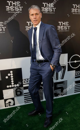 Former soccer player Marco Van Basten arrives to attend the Best FIFA soccer awards, in Milan's La Scala theater, northern Italy, . Netherlands defender Virgil van Dijk is up against five-time winners Cristiano Ronaldo and Lionel Messi for the FIFA best player award and United States forward Megan Rapinoe is the favorite for the women's award