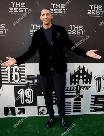 Former soccer player Marco Materazzi arrives to attend the Best FIFA soccer awards, in Milan's La Scala theater, northern Italy, . Netherlands defender Virgil van Dijk is up against five-time winners Cristiano Ronaldo and Lionel Messi for the FIFA best player award and United States forward Megan Rapinoe is the favorite for the women's award