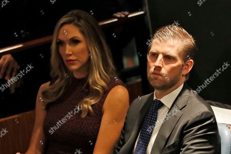 Eric and Lara Trump listen as United States President Donald Trump addresses the 74th session of the United Nations General Assembly at U.N. headquarters