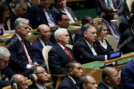 Front row from left, Vice President Mike Pence, Secretary of State Mike Pompeo, U.N, Ambassador Kelly Craft, second row from left, National Security Adviser Robert C. O'Brien, Commerce Secretary Wilbur Ross and Treasury Secretary Steve Mnuchin, listen as President Donald Trump delivers remarks to the 74th session of the United Nations General Assembly, in New York