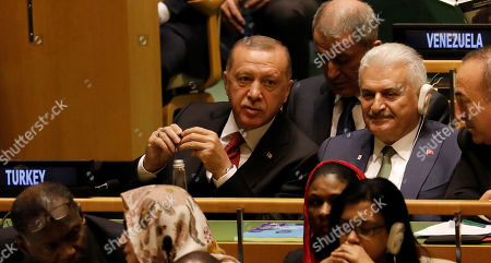 Turkish President Recep Tayyip Erdogan (L), Turkish Speaker of the Grand National Assembly Binali Yildirim (C), and Turkish Foreign Affairs Minister Melvut Cavusoglu listen as US President Donald J. Trump addresses the general debate of the 74th session of the General Assembly of the United Nations at United Nations Headquarters in New York, New York, USA, 24 September 2019. The annual meeting of world leaders at the United Nations runs until 30 September 2019.