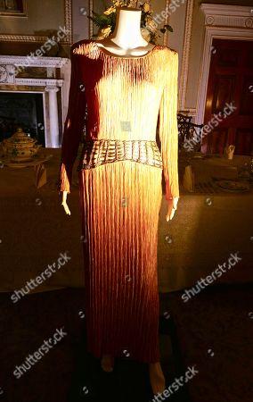 A Mary MCFadden gold pleated evening dress