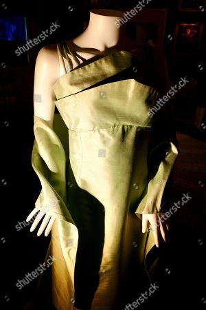 An Anthony Price green sheath evening dress