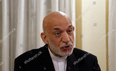 Former Afghan President Hamid Karzai speaks during an interview in Kabul, Afghanistan, . Karzai said Saturday's presidential election threatens Afghanistan's best chance of making peace with the Taliban and ending 18 years of war. Karzai, still one of the most important political figures in Afghanistan, told The Associated Press in an interview Tuesday that the vote could destabilize the country