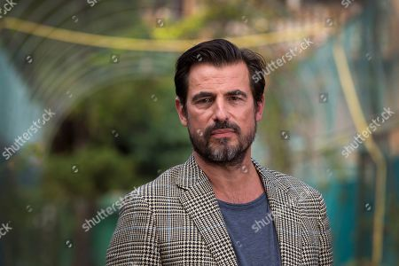 Claes Bang poses for portraits for the film 'The Burnt Orange Heresy' at the 76th edition of the Venice Film Festival, Venice, Italy