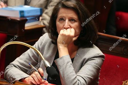 French Health Minister Agnes Buzyn attends the debate on a bill that would give single women and lesbian couples access to in-vitro fertilization, at the National Assembly, in Paris, . The bioethics bill with the measure arrives Tuesday at the National Assembly. French law currently allows assisted reproduction only for infertile heterosexual couples