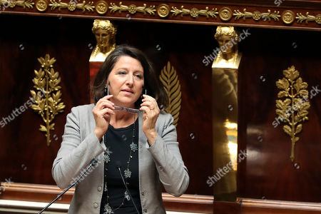 French Health Minister Agnes Buzyn gives a speech to introduce the debate on a bill that would give single women and lesbian couples access to in-vitro fertilization, at the National Assembly, in Paris, . The bioethics bill with the measure arrives Tuesday at the National Assembly. French law currently allows assisted reproduction only for infertile heterosexual couples