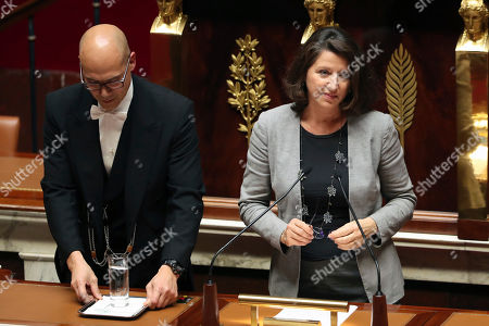 French Health Minister Agnes Buzyn prepares to give a speech on a bill that would give single women and lesbian couples access to in-vitro fertilization, at the National Assembly, in Paris, . The bioethics bill with the measure arrives Tuesday at the National Assembly. French law currently allows assisted reproduction only for infertile heterosexual couples