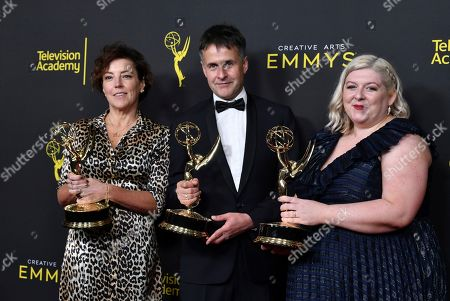 """Nina Gold, Robert Sterne, Carla Stronge. Nina Gold, from left, Robert Sterne and Carla Stronge pose in the press room with their awards for outstanding casting for a drama series for """"Game of Thrones"""" on night two of the Creative Arts Emmy Awards, at the Microsoft Theater in Los Angeles"""