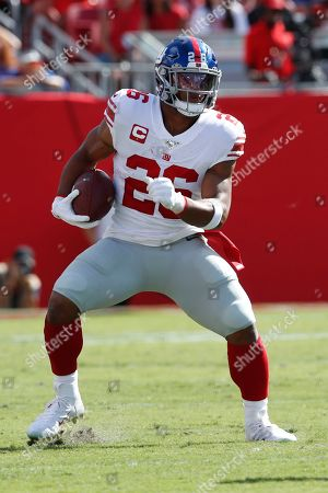 New York Giants running back Saquon Barkley (26) runs the ball against the Tampa Bay Buccaneers during an NFL football game, in Tampa, Fla. The Giants won the game 32-31