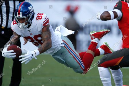 New York Giants tight end Evan Engram (88) dives for the out-of-bounds against the Tampa Bay Buccaneers during an NFL football game, in Tampa, Fla. The Giants won the game 32-31