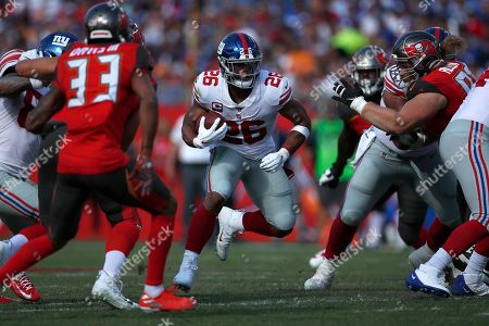 Stock Picture of New York Giants running back Saquon Barkley (26) runs the ball against the Tampa Bay Buccaneers during an NFL football game, in Tampa, Fla. The Giants won the game 32-31