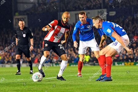 Nathan Redmond of Southampton holds off Tom Naylor  and Brandon Haunstrup of Portsmouth during Portsmouth vs Southampton, Caraboa Cup Football at Fratton Park on 24th September 2019