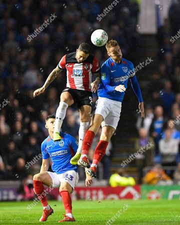 Danny Ings of Southampton and Tom Naylor of Portsmouth vie for a header during Portsmouth vs Southampton, Caraboa Cup Football at Fratton Park on 24th September 2019