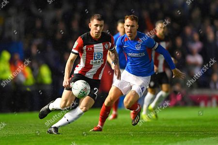 Pierre-Emile Hojbjerg of Southampton is shadowed by Tom Naylor of Portsmouth during Portsmouth vs Southampton, Caraboa Cup Football at Fratton Park on 24th September 2019