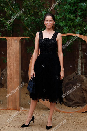 Laetitia Casta poses during a photocall before Dior's Ready To Wear Spring-Summer 2020 collection, unveiled during the fashion week, in Paris