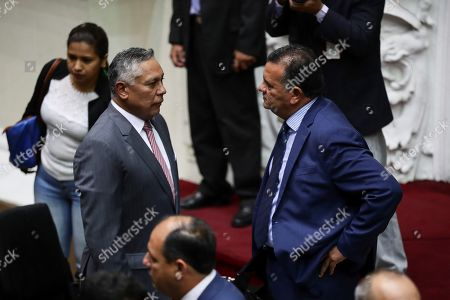 Stock Picture of Chavismo deputy Pedro Carreno (L) talks with the opposition deputy Julio Cesar Reyes (R) at the beginning of a session of the Venezuelan Parliament in Caracas, Venezuela, 24 September 2019. Chavismo deputies returned to the Venezuelan Parliament which is controlled by the opposition and led by Juan Guaido, after being absent from the Chamber since 2017, as announced a week earlier after installing a dialogue table with sectors opposition minorities.