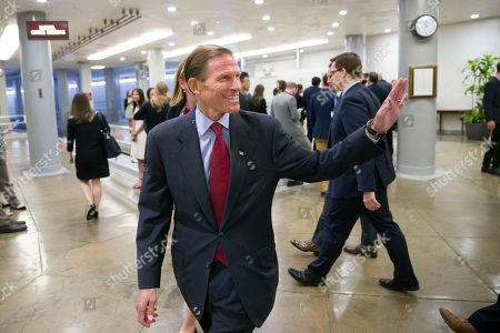 Sen. Richard Blumenthal, D-Conn., waves as he heads to the Senate for a vote, on Capitol Hill, in Washington