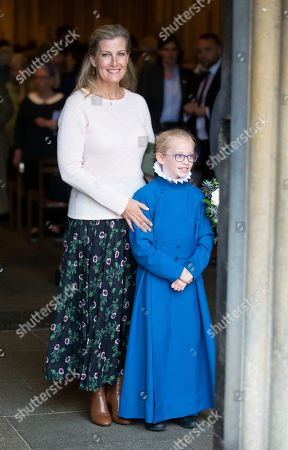 Sophie Countess of Wessex leaves Wells Cathedral after Evening Song and poses with a young chorister.