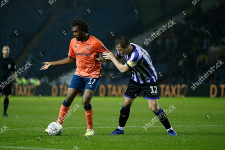 Alex Iwobi of Everton holds off Jordan Thorniley of Sheffield Wednesday during the EFL Cup match between Sheffield Wednesday and Everton at Hillsborough, Sheffield