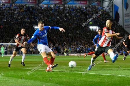 Tom Naylor (4) of Portsmouth shoots at goal during the EFL Cup match between Portsmouth and Southampton at Fratton Park, Portsmouth