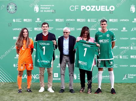 Stock Photo of Porto's goalkeeper Iker Casillas (2-L), Pozuelo's Mayoress Susana Perez (2-R), Pozuelo's president Isaac Cardoso (C) and Pozuelo's players pose for the media during an act in Madrid, Spain, 24 September 2019. Casillas collaborates with Pozuelo soccer team through his own foundation.