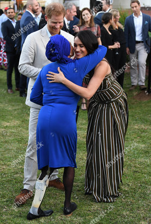 Stock Picture of Prince Harry and Megan Duchess of Sussex attends a reception for young people, community and civil society leaders at the Residence of the British High Commissioner in Cape Town, South Africa.