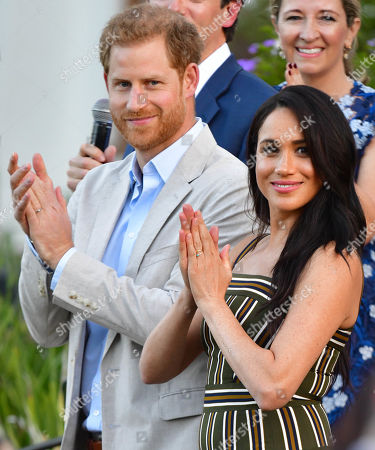 Prince Harry and Megan Duchess of Sussex attend a reception for young people, community and civil society leaders at the Residence of the British High Commissioner in Cape Town, South Africa.