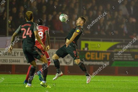 Stock Image of Stoke City player Sam Vokes wins control of a high ball in the first half during the EFL Cup match between Crawley Town and Stoke City at The People's Pension Stadium, Crawley