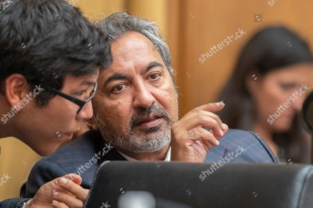 Stock Picture of Co-Chairman Ami Bera, D-Calif., confers with a staff during a House Committee on the Judiciary? Subcommittee on Immigration and Citizenship and Committee on Foreign Affairs, Subcommittee on Oversight and Investigations joint hearing on the administration's 'Muslim ban' on Capitol Hill in Washington