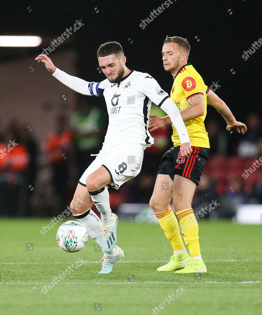 Matt Grimes of Swansea City and Tom Cleverley of Watford compete for the ball