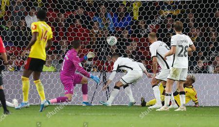 Roberto Pereyra of Watford beats Swansea City goalkeeper Kristoffer Nordfeldt to score the second goal