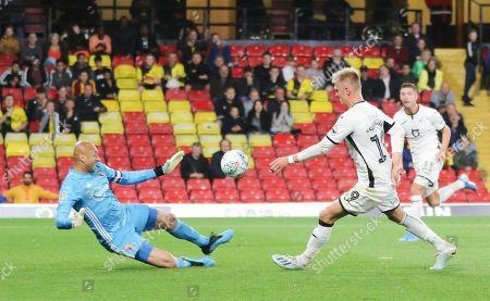 Sam Surridge of Swansea City beats Watford goalkeeper Heurelho Gomes but fails to find the goal