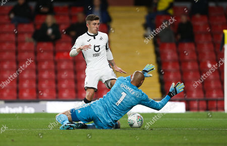 Declan John of Swansea City is denied by Watford goalkeeper Heurelho Gomes